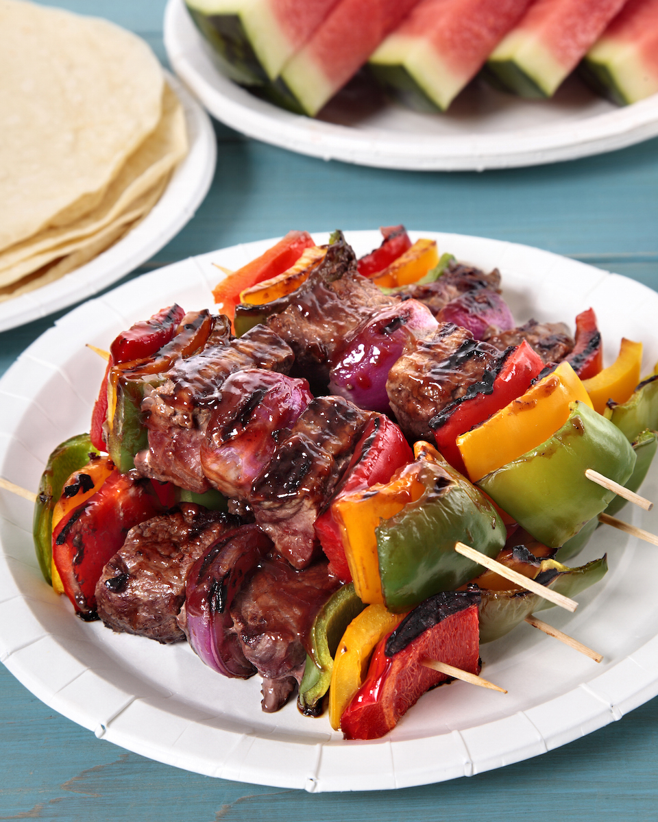 BBQ skewer with beef and vegetables on the picnic table